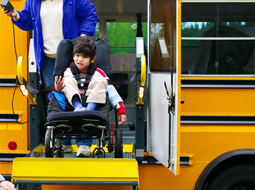 child with cerebral palsy exits schoolbus.